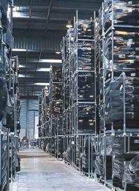 How do mobile storage racks improve warehouse efficiency?